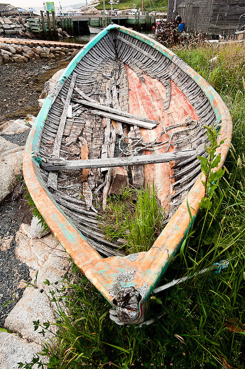 Peggy's Cove, Nova Scotia.<br /> You have to appreciate Peggy's Cove for it's authenticity. This old skiff was pulled up behind a lobster shack and abandoned for the elements to work on.  The townsfolk let it sit there, not considering it a tourist's eyesore.  And that is pretty much the case with Peggy's Cove--no airs are put on to make it appeal to people; the place is just naturally attractive and they have wisely recognized that and not touched it.  The shops are unobtrusive and out of the way.  But there's a lot of visitors, so get there early or stay late.  Time has not been kind to this old girl, but she still commanded a second look from me.