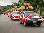 31 AUGUST 2014 - SARIKA, NAKHON NAYOK, THAILAND: Trucks carrying statues of Ganesh go to a river where statues of Ganesh will be submerged at Shri Utthayan Ganesha Temple in Sarika, Nakhon Nayok. Ganesh Chaturthi, also known as Vinayaka Chaturthi, is a Hindu festival dedicated to Lord Ganesh. It is a 10-day festival marking the birthday of Ganesh, who is widely worshiped for his auspicious beginnings. Ganesh is the patron of arts and sciences, the deity of intellect and wisdom -- identified by his elephant head. The holiday is celebrated for 10 days, in 2014, most Hindu temples will submerge their Ganesh shrines and deities on September 7. Wat Utthaya Ganesh in Nakhon Nayok province, is a Buddhist temple that venerates Ganesh, who is popular with Thai Buddhists. The temple draws both Buddhists and Hindus and celebrates the Ganesh holiday a week ahead of most other places.    PHOTO BY JACK KURTZ