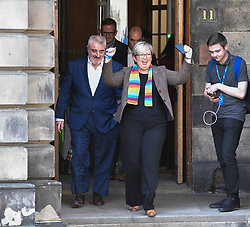 Pictured: MP's Joanna Cherry and Tommy Shepherd celebrate after the ruling.<br /> <br /> A cross-party group of over 70 politicians today won their appeal before the Court of Session seeking to rule that the UK government and Prime Minister Boris Johnson acted unlawfully in proroguing parliament.<br /> <br /> © Dave Johnston / EEm