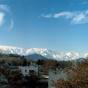 December 1976<br /> Kolola Pushta Fort (highlighted in upper left) overlooks the gardens and houses of Shahr-e-Nao. On the 14th of December 1928, Habibullah Ghazi (a.k.a.Bacha Saqqao), advanced on Kabul with some 1000 men and successfully captured this fort which he found well stocked with arms and ammunition. He bombarded the city with them until it fell on the 19th of January 1929, effectively ending the reign of King Amanullah.