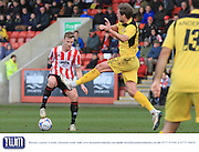 Kyle Storer and Adam Cunnington during the Vanarama National League match between Cheltenham Town and Bromley at Whaddon Road, Cheltenham, England on 30 January 2016. Photo by Antony Thompson.