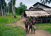 Small boys laughing together in a village settlement, Solomon Isles, South Pacific