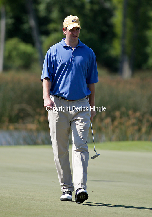 2009 April 22: Eli Manning quarterback of the NFL, New York Giants football team walks the green of the 18th hole during the PGA Tour, Zurich Classic of New Orleans Classic Pro-Am played at TPC Louisiana in Avondale, Louisiana.