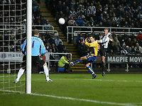 Photo: Andrew Unwin.<br />Newcastle United v Mansfield Town. The FA Cup.<br />07/01/2006.<br />Newcastle's Alan Shearer (R) takes a shot at goal.