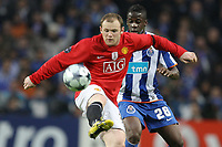 20090415: PORTO, PORTUGAL - FC Porto vs Manchester United: Champions League 2008/2009 Ð Quarter Finals Ð 2nd leg. In picture: Rooney and Cissokho. PHOTO: Ricardo Estudante/CITYFILES