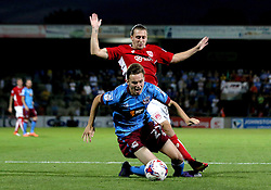 Conor Townsend of Scunthorpe United is brought down by Luke Freeman of Bristol City - Mandatory by-line: Robbie Stephenson/JMP - 23/08/2016 - FOOTBALL - Glanford Park - Scunthorpe, England - Scunthorpe United v Bristol City - EFL Cup second round