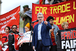 © Licensed to London News Pictures. 01/05/2018. LONDON, UK.  Mick Cash, leader of the RMT union addresses demonstrators during the annual May Day Rally on International Workers' Day, having marched through central London to a rally in Trafalgar Square.  Photo credit: Stephen Chung/LNP