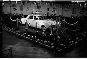 "Launch Of New Ford Corsair..1963..01.10.1963..10.01.1963..1st October 1963..Today saw the launch of a new car to the market. At the Smithfield Motor Company in Drumcondra, Ford launched ""The Corsair"".,The Corsair was one of the four model Consul range, and shared many of its mechanical components with the Cortina, Classic and Capri. The Corsair had unusual and quite bold styling for its day, with a sharp horizontal V-shaped crease at the very front of the car into which round headlights were inset...Image shows the New Ford Corsair on the display stand at the Smithfield Motor Company in Drumcondra."