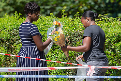 Two women describing themselves as family friends lay flowers where a man in his 40s locally named as Tesfa Campbell, was stabbed on Latchmere Road in Battersea in the afternoon of July 3rd 2019, dying later that evening in hospital.. London, July 04 2019.
