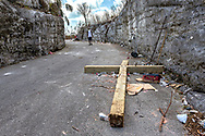 A fallen wooden cross lies on the side of the road after Hurricane Dorian ripped it off the hilltop outside Saint Francis Catholic Church in Marsh Harbour on Great Abaco Island on Saturday, September 7, 2019.