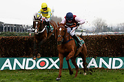 Winner Bentelimar  and Jonathan Burke and second placed Theinval and Jeremiah McGrath (Yellow Cap) at the last fence in The Zut Media Red Rum Handicap Steeple Chase Race at Aintree, Liverpool, United Kingdom on 12 April 2018. Picture by Craig Galloway.