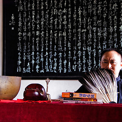 Chinesse Budhist monk and blackboard, Xian, Shaanxi, China.