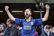 AFC Wimbledon fans celebrating win during the EFL Sky Bet League 1 match between Southend United and AFC Wimbledon at Roots Hall, Southend, England on 12 October 2019.