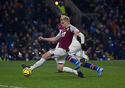 Ben Mee of Burnley (L) slides in to block a shot - Mandatory by-line: Jack Phillips/JMP - 30/11/2019 - FOOTBALL - Turf Moor - Burnley, England - Burnley v Crystal Palace - English Premier League
