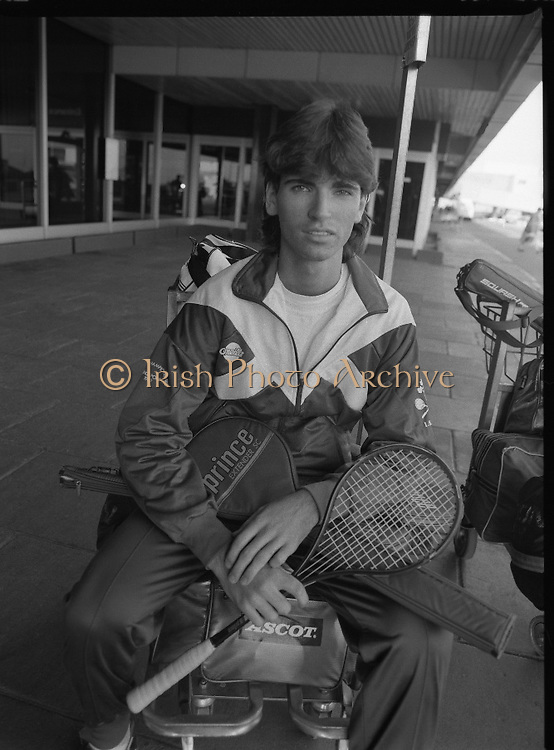 Irish Squash Team Return From Singapore. (T8)..1989..20.10.1989..10.20.1989..20th October 1989..The Irish squash team arrived home from Singapore where the World Squash Championships were held...Image shows Derek Ryan,(19),the Irish No 1 squash player at Dublin Airport after his arrival from Singapore. His trip was marred somewhat by an unfounded allegation that he had used stimulants. The Danish team who made the accusation later apologised for the claim.