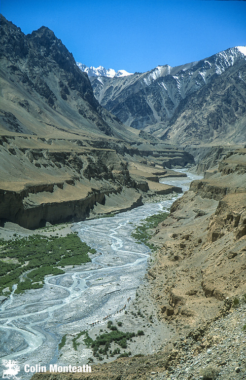 Bactrian camel caravan crosses braided  rivers, Aghil range, Chongtar expedition 1994, Karakoram mtns, far western China, Central Asia.