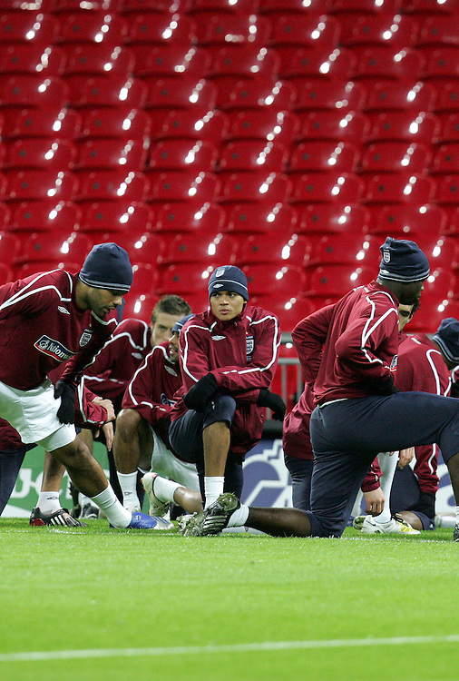 Jermaine Jenas stretches as Fabio Capello takes charge of his first England training session in front of the media at Wembley Stadium, 4th Feb 2007.