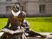 "04 APRIL 2020 - DES MOINES, IOWA: Somebody put a mask on a statue in front of the courthouse in Des Moines. On Saturday morning, 04 April, Iowa reported 786 confirmed cases of the Novel Coronavirus (SARS-CoV-2) and COVID-19. There have been 14 deaths attributed to COVID-19 in Iowa. Restaurants, bars, movie theaters, places that draw crowds are closed until 30 April. The Governor has not ordered ""shelter in place"" but several Mayors, including the Mayor of Des Moines, have asked residents to stay in their homes for all but the essential needs. People are being encouraged to practice ""social distancing"" and many businesses are requiring or encouraging employees to telecommute.        PHOTO BY JACK KURTZ"