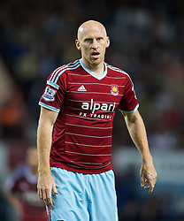 LONDON, ENGLAND - Saturday, September 20, 2014: West Ham United's James Collins in action against Liverpool during the Premier League match at Upton Park. (Pic by David Rawcliffe/Propaganda)