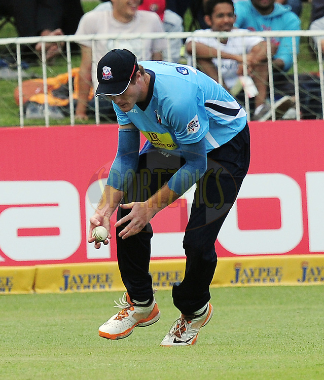 Martin Guptill going for the ball during match 8 of the Karbonn Smart CLT20 South Africa between The Titans and The Auckland Aces held at Kingsmead Park in Durban, South Africa on the 17th October 2012..Photo by Gerhard Duraan/SPORTZPICS/CLT20