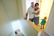 PRICE CHAMBERS / NEWS&amp;GUIDE<br /> After a year of working on it, Habitat for Humanity home recipients Jim and Lisa Wolfgang smile as their daughters Isabella and Sophie, 3, explore their completed Teton Village home on July 19, 2013.