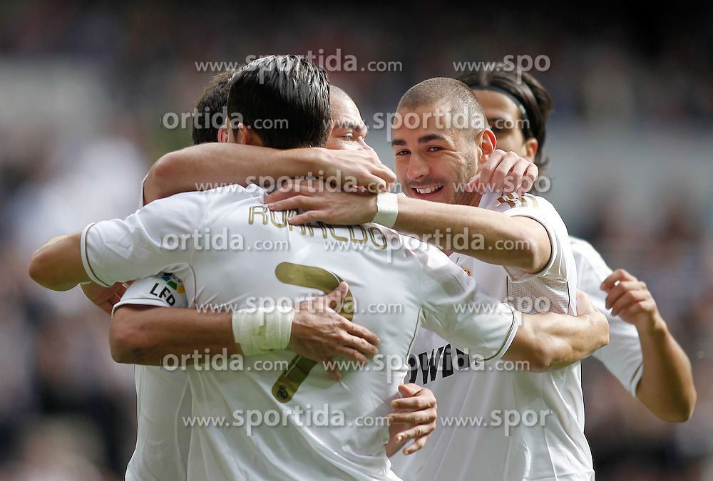06.11.2011, Santiago Bernabeu Stadium, Madrid, ESP, Primera Division, Real Madrid vs CA Osasuna, im Bild  Real Madrid's Cristiano Ronaldo celebrates with Karim Benzema // during Primera Division league football match between Real Madrid an CA Osasuna at Santiago Bernabeu Stadium, Madrid, Spain on 06/11/2011. EXPA Pictures © 2011, PhotoCredit: EXPA/ Alterphoto/ Alvaro Hernandez +++++ ATTENTION - OUT OF SPAIN/(ESP) and OUT OF SWISS/(SUI) ++++