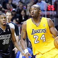 19 January 2012:  Los Angeles Lakers shooting guard Kobe Bryant (24) drives past Miami Heat point guard Norris Cole (30) during the Miami Heat 98-87 victory over the Los Angeles Lakers at the AmericanAirlines Arena, Miami, Florida, USA.