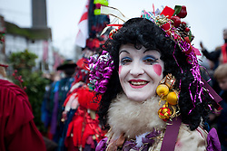 © Licensed to London News Pictures. 06/01/2013. London, UK. A member of the 'Bankside Mummers' dressed as the 'Prudence' is seen performing at the annual 'Twelfth Night' Celebration in London today (06/01/13). The tradition, a pagan celebration of the new year and the end if Christmas, takes place every year at Bankside outside the Globe Theatre and sees the actors of the Bankside Mummers perform for the public. Photo credit: Matt Cetti-Roberts/LNP