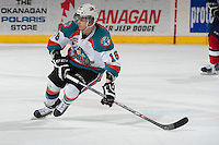 KELOWNA, CANADA - MARCH 22: Kris Schmidli #16 of the Kelowna Rockets skates against the Tri-City Americans on March 22, 2014 at Prospera Place in Kelowna, British Columbia, Canada.   (Photo by Marissa Baecker/Shoot the Breeze)  *** Local Caption *** Kris Schmidli;