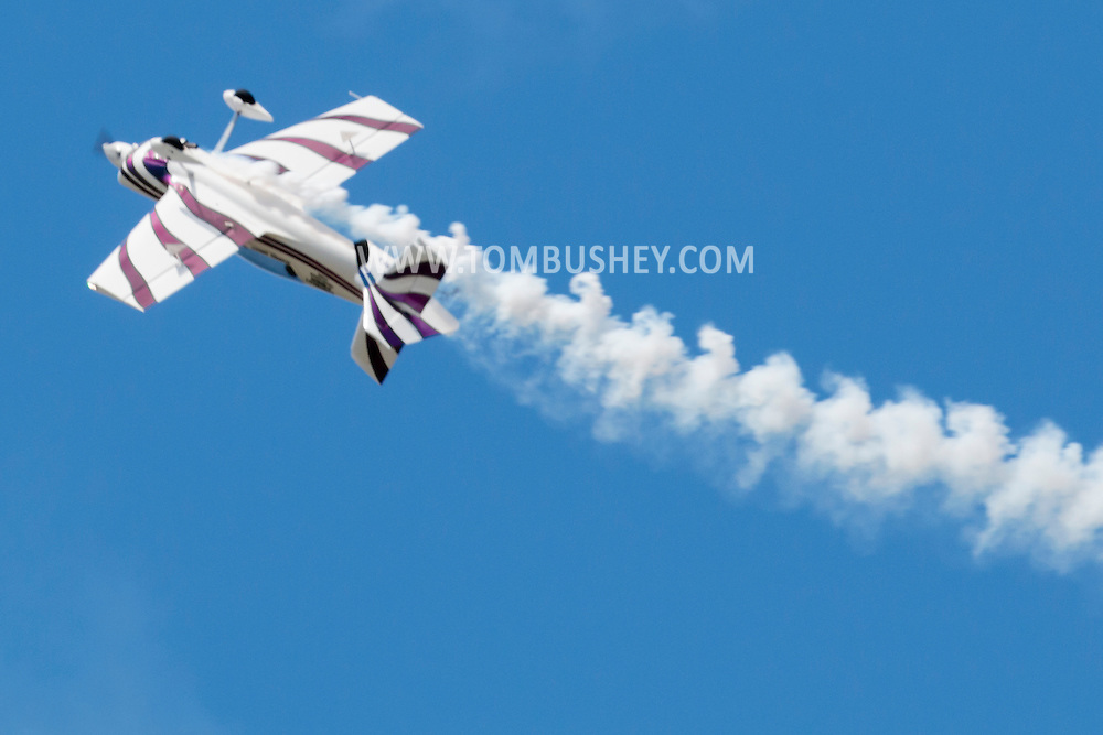 The tail breaks off a stunt plane during practice for the New York Air Show  at Stewart International Airport in New Windsor, New York, on Aug. 28, 2015. The plane crashed and killed pilot Andrew Wright of Austin, Texas. He was the only one on the plane. The smoke coming from the plane is part of the show.