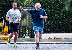 © Licensed to London News Pictures . 28/09/2017. London, UK. British foreign secretary BORIS JOHNSON, Seen running in Westminster, London with his security (face pixelated) on September 28, 2017. Boris Johnson has been accused of challenging government Brexit strategy ahead of Conservative Party Conference which starts in Manchester on Sunday. Photo credit: Ben Cawthra/LNP
