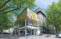 "A McDonalds once branded the ""ugliest building in Rotterdam"" is enjoying a new lease of life as the poshest Maccies in the world. Looking more like a modern art gallery with glass floor-to-ceiling windows, this recently refurbished McDonalds in the Dutch city of Rotterdam is possibly the poshest in the world. Located on the iconic Coolsingel in the city's ""Cool District"" - the fast-food eatery comes complete with grand central spiral staircase leading to the second floor and also boasts an outside terrace so customers can enjoy their Big Macs al fresco if they desire. The seats are upholstered in fine leather and the tables are made from marble while outside the perforated golden facade gives the location an extra special dazzling appeal and is a far cry from it's former dated boxy appearance. The restaurant was completed at the end of 2015 after design firm Mei Architects were brought in to overhaul the dated building. And after a very fast construction the newly re-modeled building was completed in just two months. 09 Nov 2017 Pictured: This recently refurbished McDonalds in Rotterdam in The Netherlands is possibly the poshest in the world with floor-to-ceiling glass frontage and a perforated gold facade. Photo credit: Mei architects/Jeroen Musch/MEGA TheMegaAgency.com +1 888 505 6342"