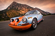 Image of a blue 1967 911S Porsche sports car on a road in Utah, American Southwest
