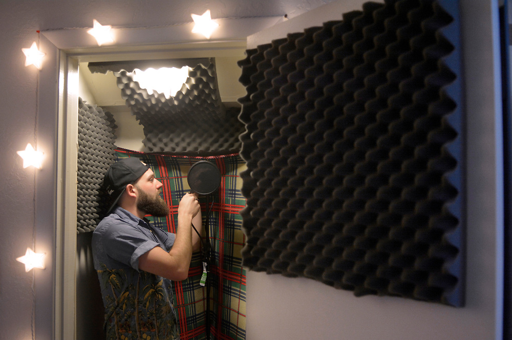 gbs031417u/ARTS -- Manu Sandoval works on a microphone in a closet singing booth of Maple St. Records. (Greg Sorber/Albuquerque Journal)
