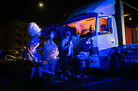 """ROME, ITALY - 27 JUNE 2017: Opera actors are seen here before walking up on stage to perform for the """"Don Giovanni OperaCamion"""", an open-air opera performed on a truck in San Basilio, a suburb in Rome, Italy, on June 27th 2017.<br /> <br /> Director Fabio Cherstich's idae of an """"opera truck"""" was conceived as a way of bringing the musical theatre to a new, mixed, non elitist public, and have it perceived as a moment of cultural sharing, intelligent entertainment and no longer as an inaccessible and costly event. The truck becomes a stage that goes from square to square with its orchestra and its company of singers in Rome. <br /> <br /> """"Don Giovanni Opera Camion"""", after """"Don Giovanni"""" by Wolfgang Amadeus Mozart is a new production by the Teatro dell'Opera di Roma, conceived and directed by Fabio Cherstich. Set, videos and costumes by Gianluigi Toccafondo. The Youth Orchestra of the Teatro dell'Opera di Roma is conducted by Carlo Donadio."""