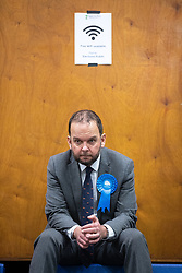 © Licensed to London News Pictures . 13/12/2019. Bury, UK. Conservative candidate for Bury North JAMES DALY sits and waits during recount , at the count for seats in the constituencies of Bury North and Bury South in the 2019 UK General Election , at Castle Leisure Centre in Bury . Photo credit: Joel Goodman/LNP
