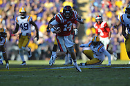 Ole Miss quarterback Bo Wallace (14) scores on a 58 yard run in the  first quarter vs. Tiger Stadium in Baton Rouge, La. on Saturday, November 17, 2012....