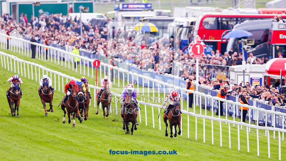 Imshivalla ridden by Paul Hanagan (Red, white chevron) wins the Investec Wealth &amp; Investment Handicap on Ladies Day of the Investec Derby Festival at Epsom Racecourse, Epsom, UK.<br /> Picture by Mark Chappell/Focus Images Ltd +44 77927 63340<br /> 03/06/2016