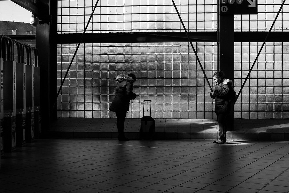 Two ladies at the 74th and Broadway Stop