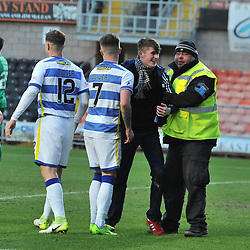A Morton fan is escorted away by stewards after running onto the pitch after Thomas O'Ware (Morton) opened the scoring during the Scottish Championship match between Dundee United and Greenock Morton at Tannadice.<br /> <br /> (c) Dave Johnston | sportPix.org.uk