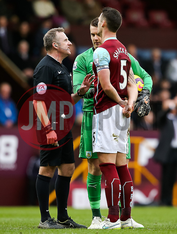 Burnley Captain Jason Shackell argues with Referee John Moss - Photo mandatory by-line: Matt McNulty/JMP - Mobile: 07966 386802 - 28/02/2015 - SPORT - Football - Burnley - Turf Moor - Burnley v Swansea City - Barclays Premier League