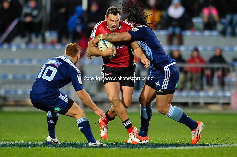 Israel Dagg of the Crusaders is tackled by Ihaia West and Ma'a Nonu of the Blues in the Super rugby match,  Crusaders v The Blues, at AMI Stadium, Christchurch, on the 5 July 2014 . Photo:John Davidson/www.photosport.co.nz