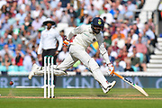 Ravindra Jadeja of India has to hurry to avoid being run out as the ball is thrown at the stumps by Alastair Cook of England during day 3 of the 5th test match of the International Test Match 2018 match between England and India at the Oval, London, United Kingdom on 9 September 2018.