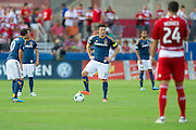 FRISCO, TX - AUGUST 11:  Robbie Keane #7 of the Los Angeles Galaxy stands with Landon Donovan #10 before kickoff against FC Dallas on August 11, 2013 at FC Dallas Stadium in Frisco, Texas.  (Photo by Cooper Neill/Getty Images) *** Local Caption *** Robbie Keane; Landon Donovan