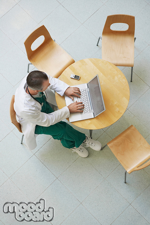 Doctor Using Laptop in cafeteria view from above