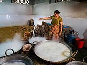 09 MARCH 2017 - BHAKTAPUR, NEPAL: Making yogurt in a home workshop in Bhaktapur, Nepal. Yogurt made in Bhaktapur is considered the finest yogurt in Nepal.     PHOTO BY JACK KURTZ