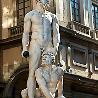 "The original Photo: The white marble sculpture Hercules and Cacus the entrance of the Palazzo Vecchio and the Uffizi Gallery in the Piazza della Signoria, Florence, Italy. Search the archive for ""sculpture Florence"" for black-and-white and monochromatic versions of this photograph."