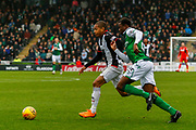 Simeon Jackson of St Mirren get the better of Efe Ambrose of Hibernian FC during the Ladbrokes Scottish Premiership match between St Mirren and Hibernian at the Simple Digital Arena, Paisley, Scotland on 29th September 2018.