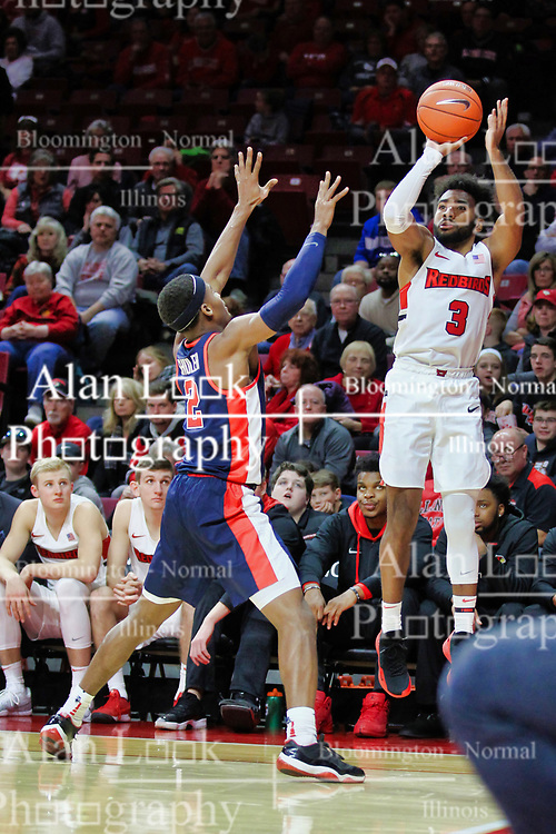 NORMAL, IL - December 08: Keyshawn Evans shoots a three over Devontae Shuler during a college basketball game between the ISU Redbirds and the University of Mississippi (Ole Miss) Rebels on December 08 2018 at Redbird Arena in Normal, IL. (Photo by Alan Look)