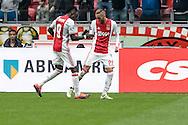 02-10-2016: Voetbal: Ajax v FC Utrecht: Amsterdam<br /> <br /> (L-R) Ajax speler Bertrand Traore viert een feestje met Ajax speler Hakim Ziyech die zojuist gescoord (3-1) heeft tijdens het Eredivsie duel tussen Ajax en FC Utrecht op 2 oktober 2016 in stadion Arena in Amsterdam tijdens speelronde 8<br /> <br /> Eredivisie - Seizoen 2016 / 2017<br /> <br /> Foto: Gertjan Kooij